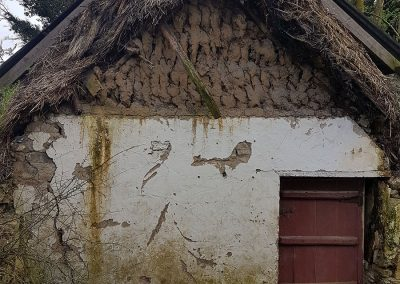 Old tin roofed thatched cottage